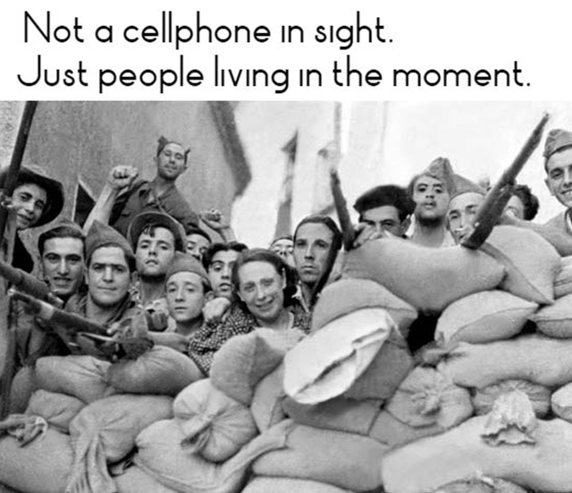Not a cellphone in sight. Just people living in the moment – which us the barricades of Barcelona in 1936.